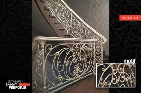 Wrought Iron Stair Railing With White Flower Pattern